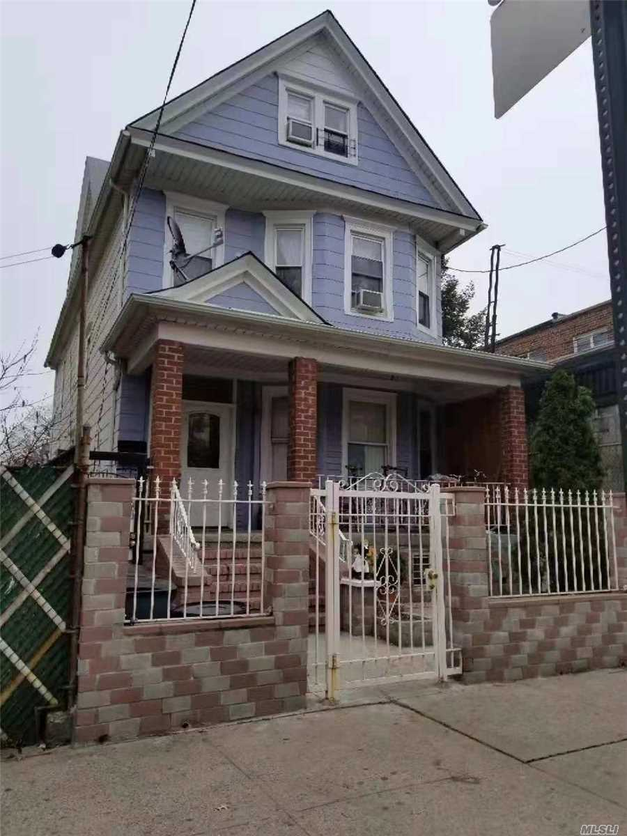 Photo of home for sale at 50-09 90th St, Elmhurst NY
