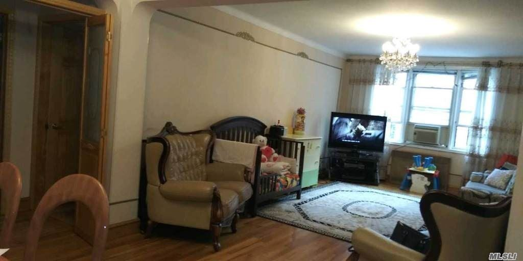 Photo of home for sale at 63-61 99 St, Rego Park NY