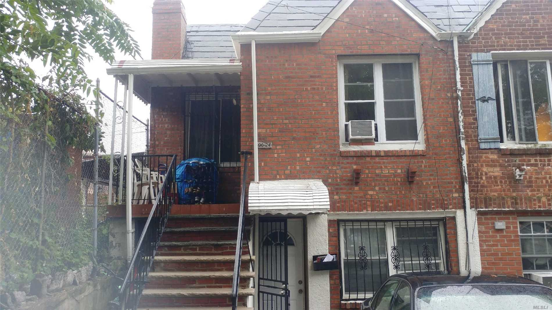 Photo of home for sale at 90-24 24 Rd, East Elmhurst NY