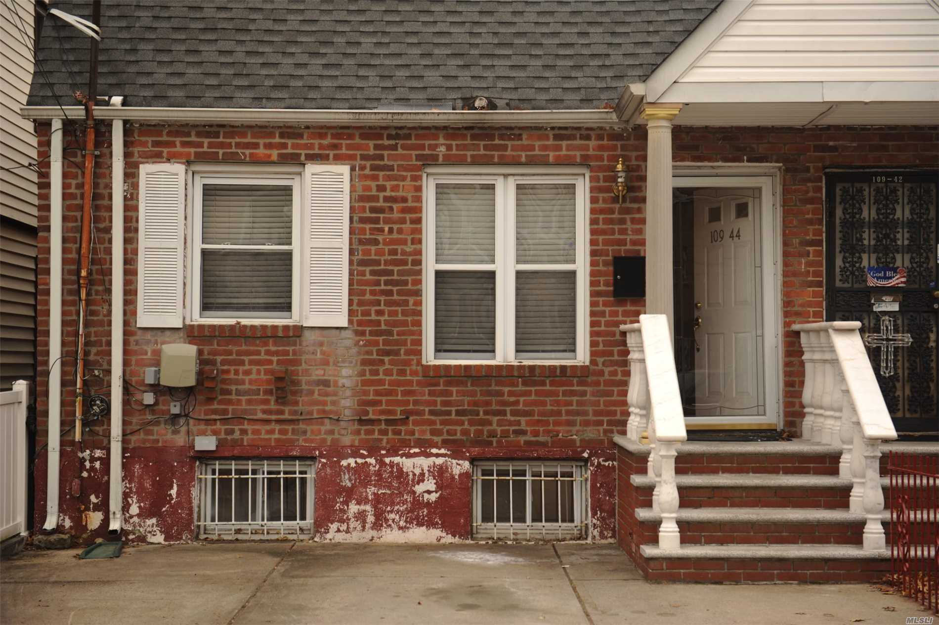 Photo of home for sale at 10944 174 St, Jamaica NY