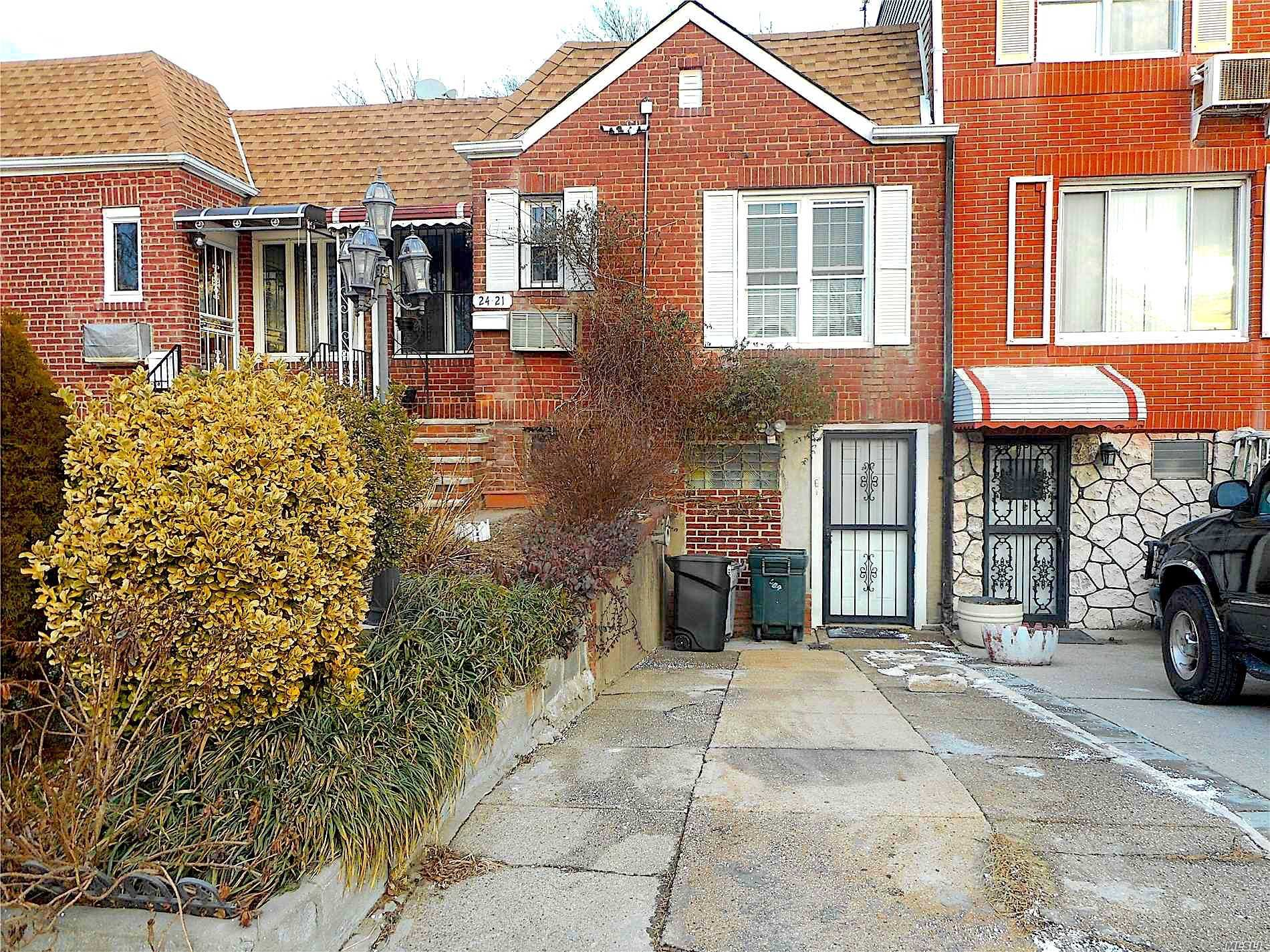 Photo of home for sale at 24-21 92nd St, East Elmhurst NY