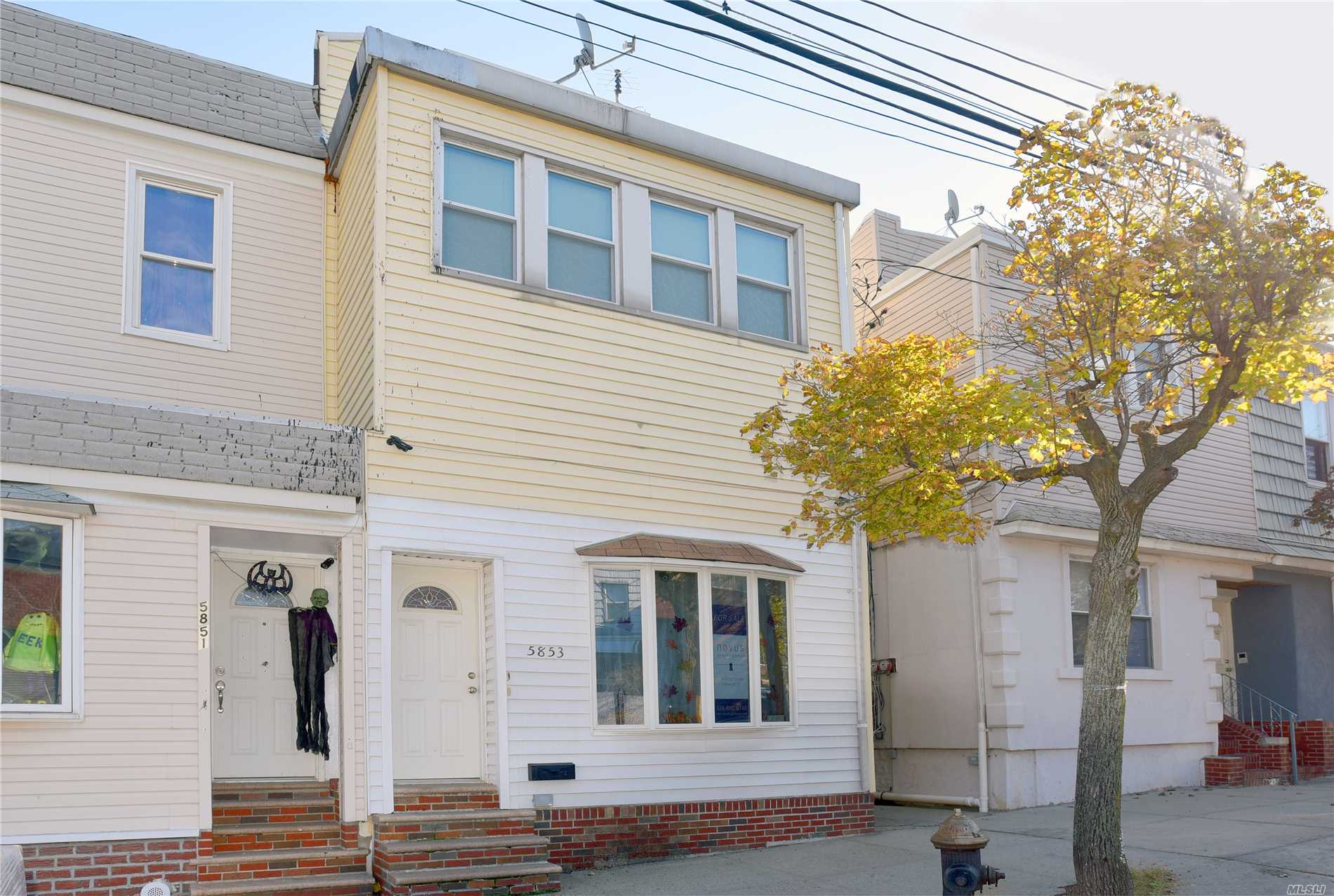 Photo of home for sale at 58-53 59th St, Maspeth NY