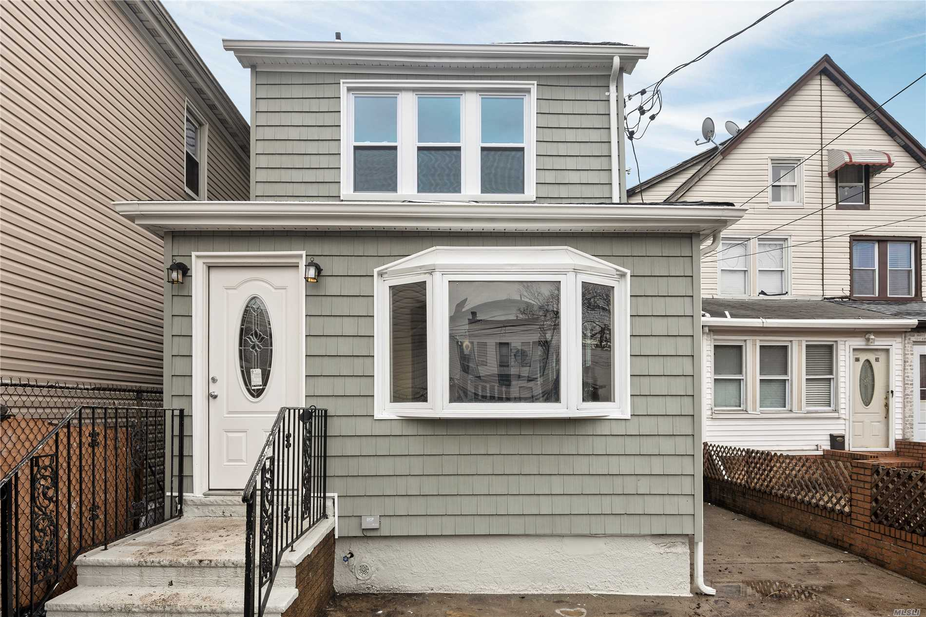 Photo of home for sale at 112-32 Dillon St, Jamaica NY