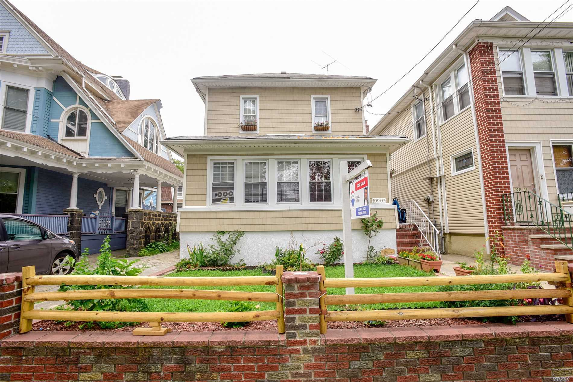 Photo of home for sale at 109-07 86th Ave, Richmond Hill North NY