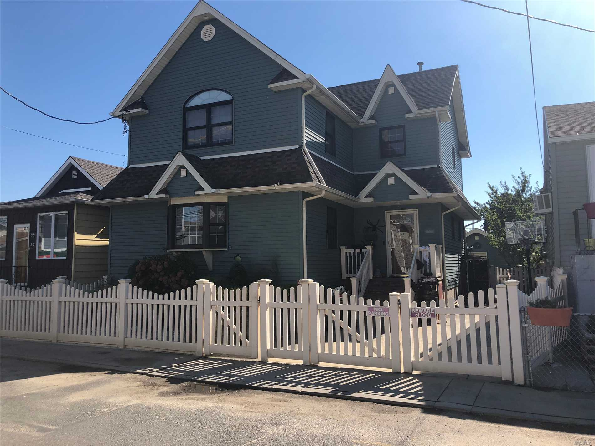 Photo of home for sale at 99-78 164 Rd, Howard Beach NY