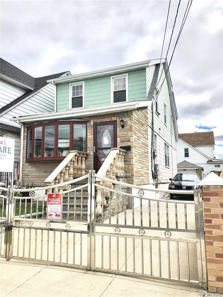 Photo of home for sale at 129-22 95th Ave, Richmond Hill South NY