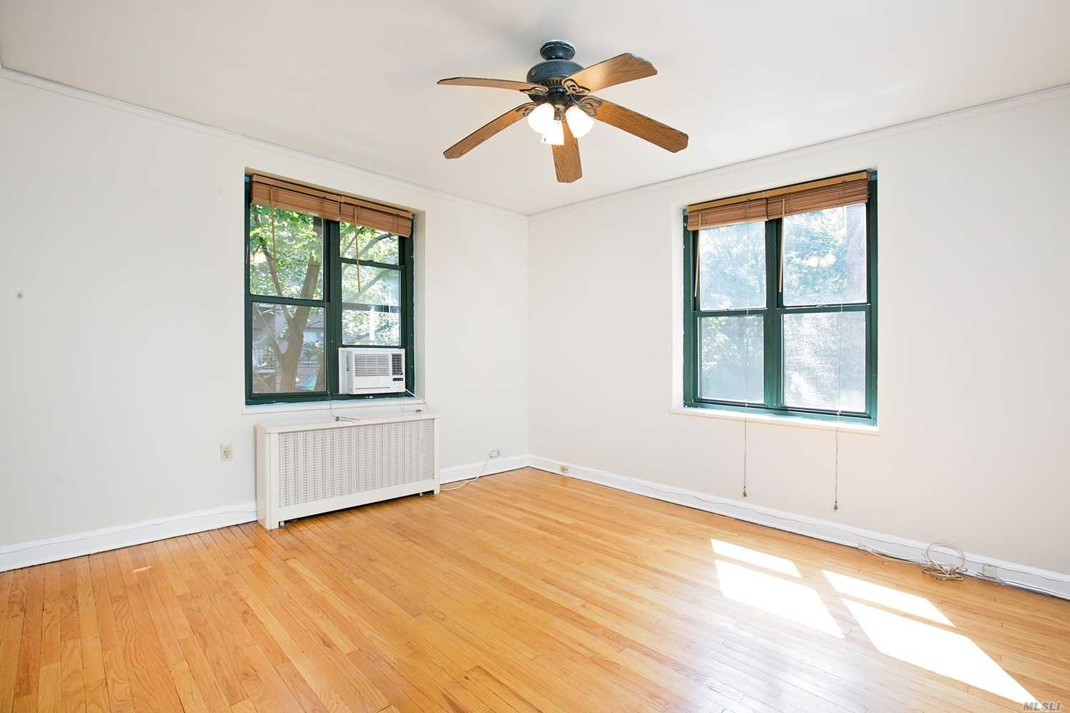 Photo of home for sale at 34-41 78 St, Jackson Heights NY