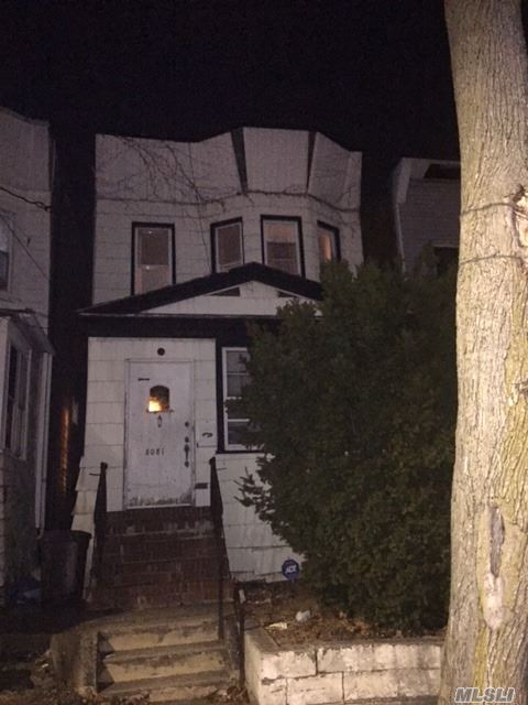 Photo of home for sale at 80-81 88th Ave, Jamaica NY