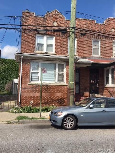 Photo of home for sale at 31-54 97 St, East Elmhurst NY