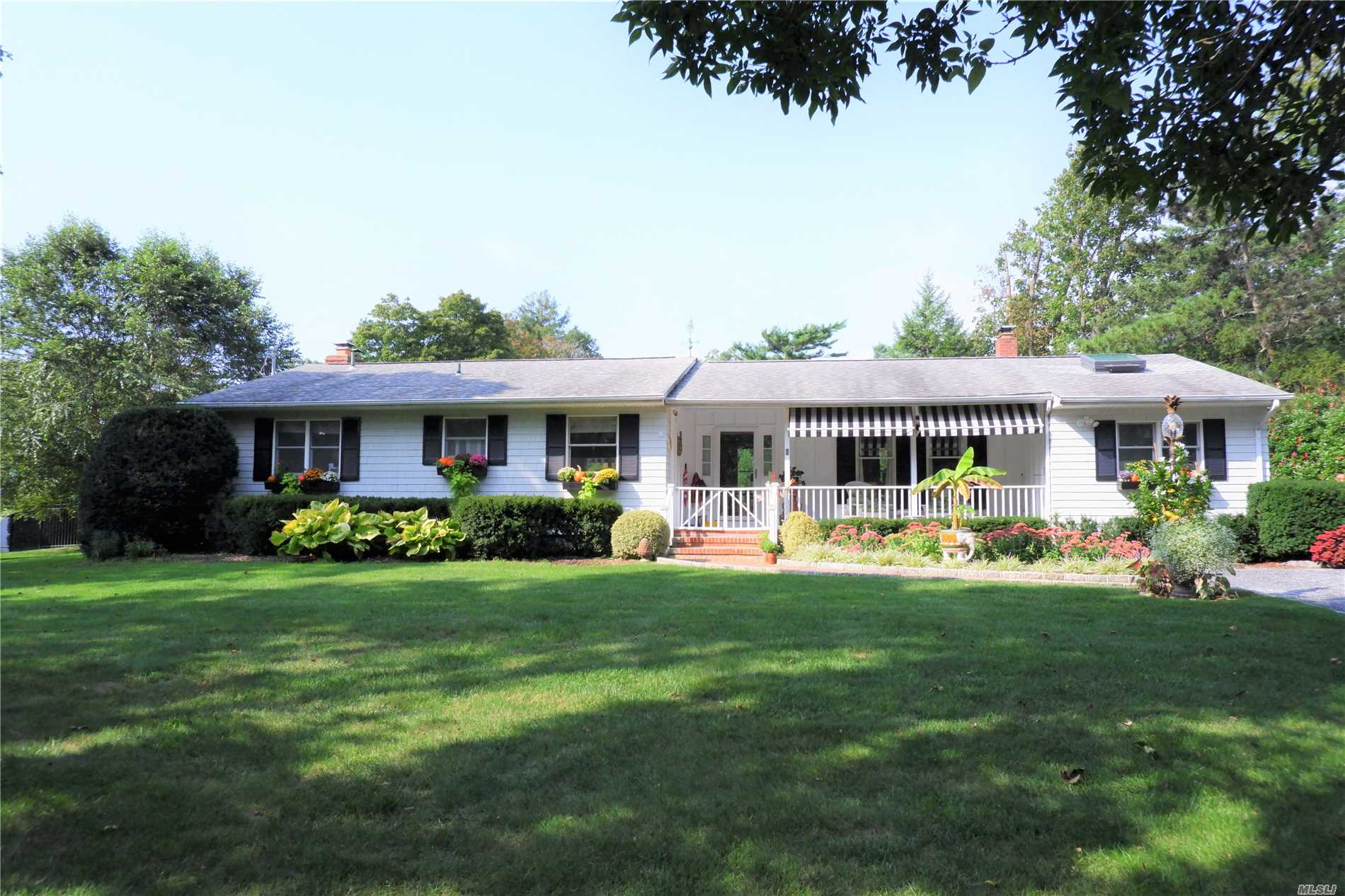 Photo of home for sale at 6 Howells Point Rd S, Bellport Village NY