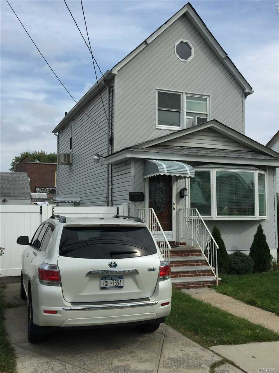 Photo of home for sale at 9511 238th St, Floral Park NY