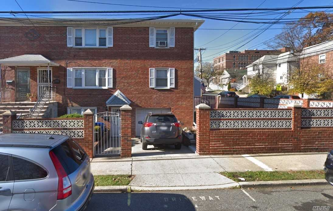 Photo of home for sale at 9-04 130 Street, College Point NY