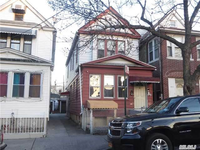 Photo of home for sale at 32-39 95th St, East Elmhurst NY