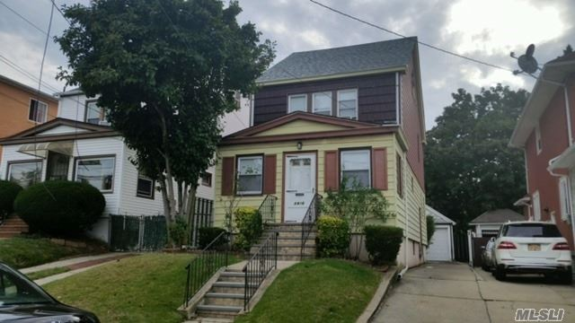 Photo of home for sale at 84-16 169 St, Jamaica Hills NY