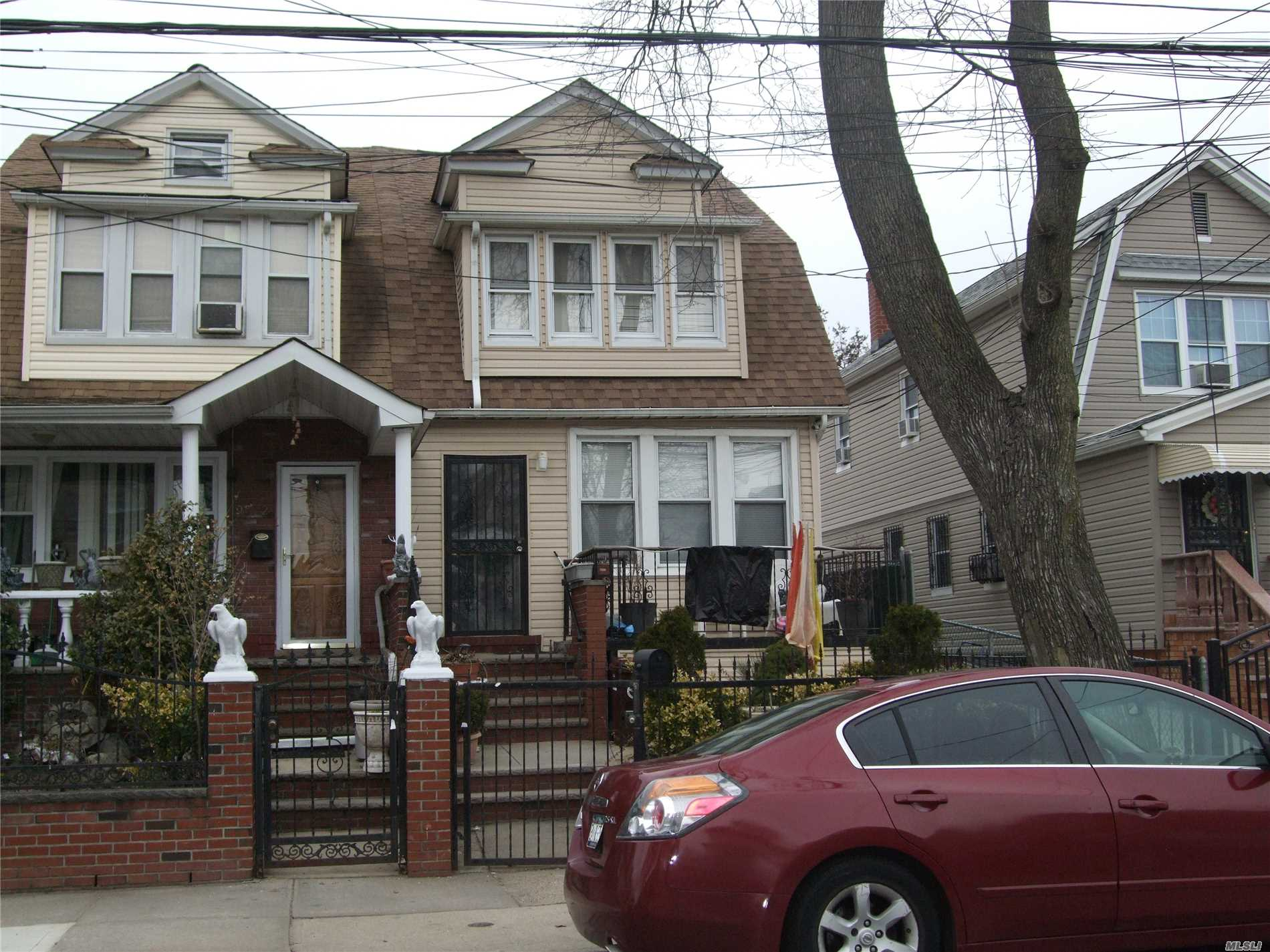 Photo of home for sale at 95-10 126th St, Richmond Hill NY