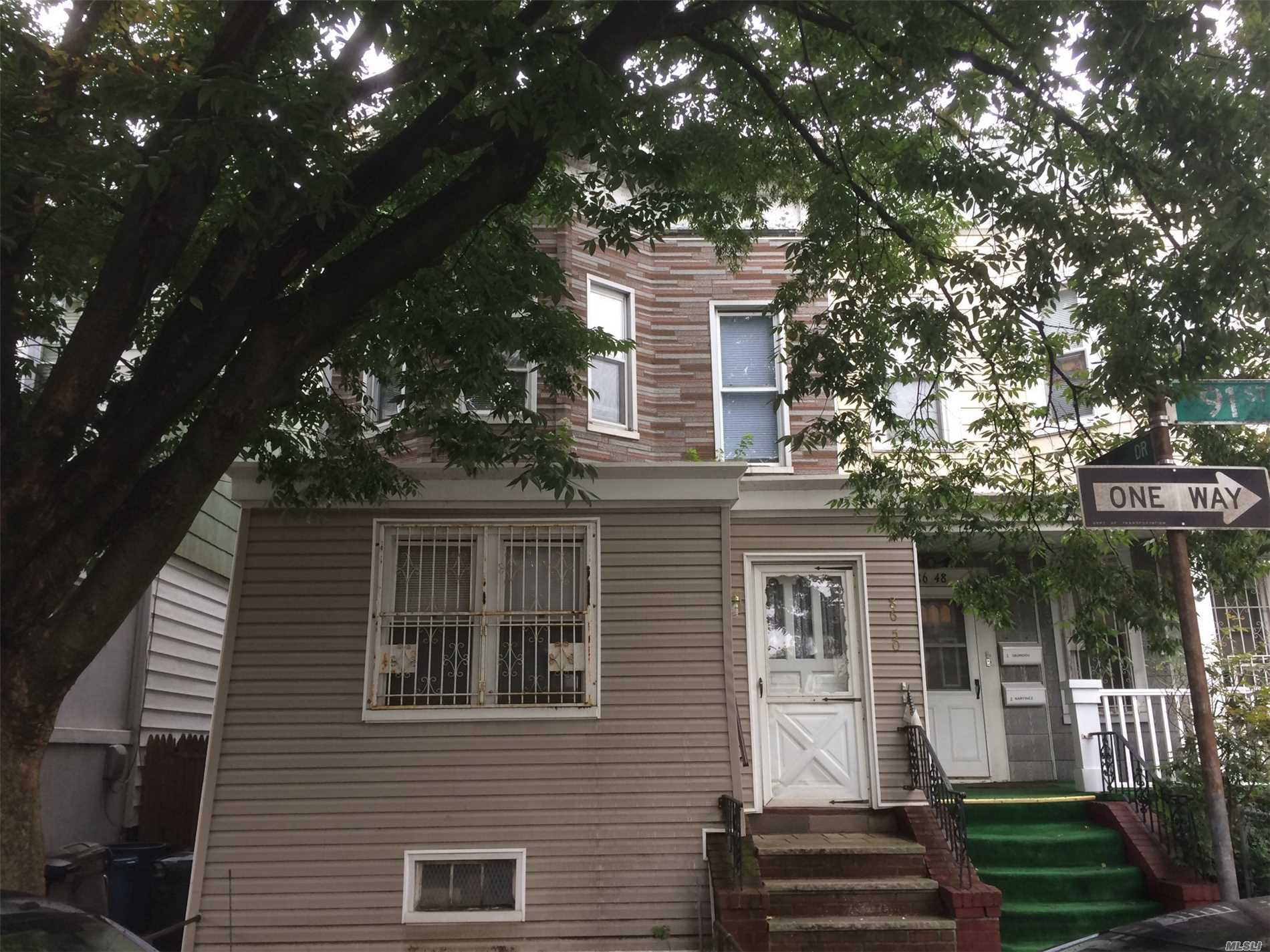 Photo of home for sale at 86-50 91st St, Woodhaven NY
