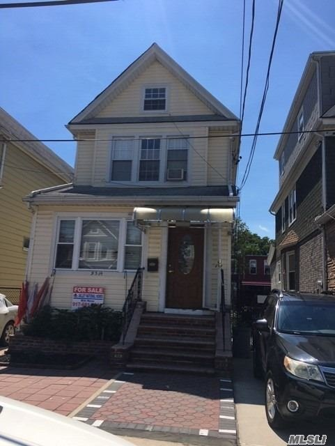 Photo of home for sale at 95-14 81st St, Ozone Park NY
