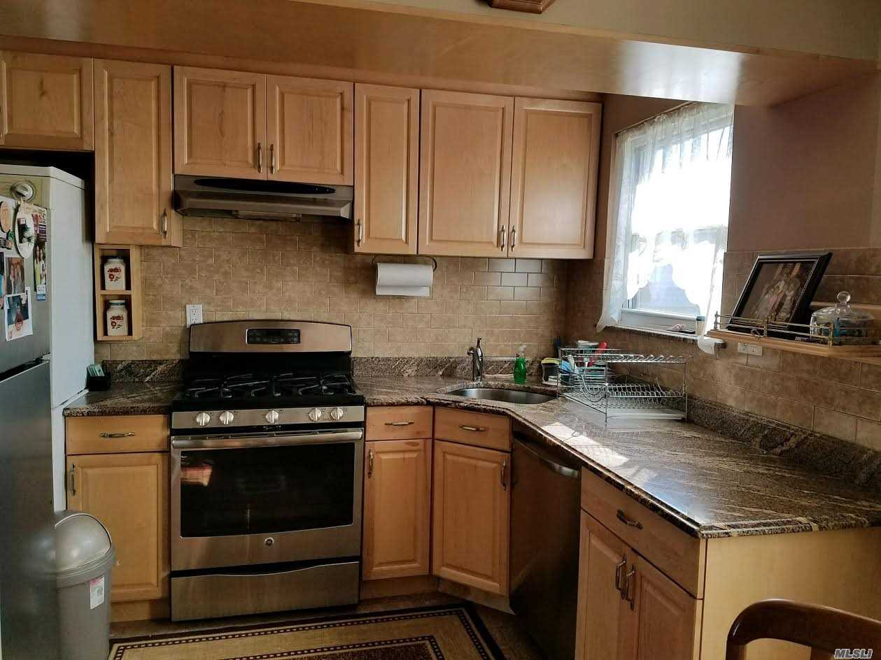Photo of home for sale at 68-67 218 St, Bayside NY