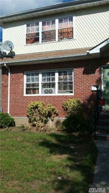 Photo of home for sale at 119-27 165th St, Jamaica NY