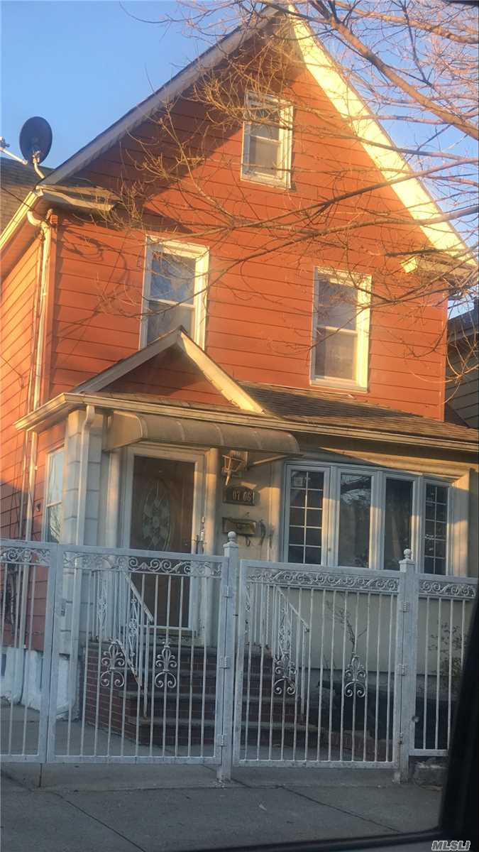Photo of home for sale at 107-06 Inwood St, Jamaica NY