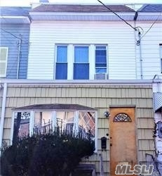 Photo of home for sale at 69-06 78th St, Middle Village NY