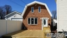 Photo of home for sale at 3955 South St, Seaford NY