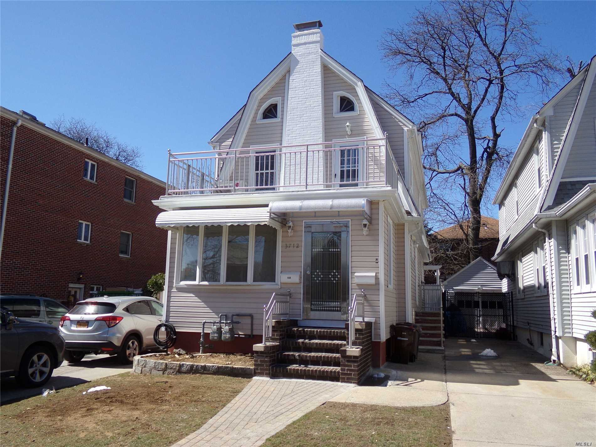 Photo of home for sale at 37-12 Utopia Pky, Flushing NY
