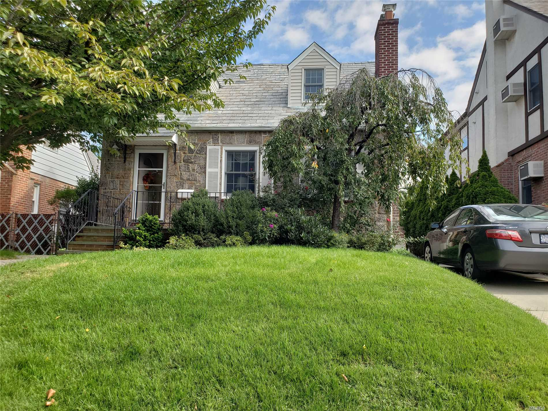 Photo of home for sale at 53-19 211 St, Bayside NY