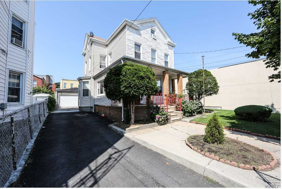 Photo of home for sale at 97-34 86 St, Ozone Park NY