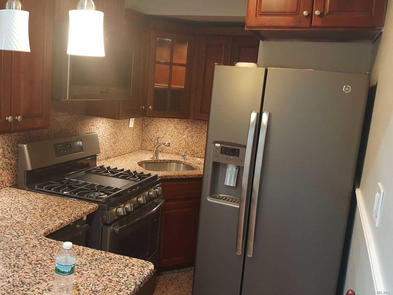 Photo of home for sale at 59-21 Calloway Street, Corona NY