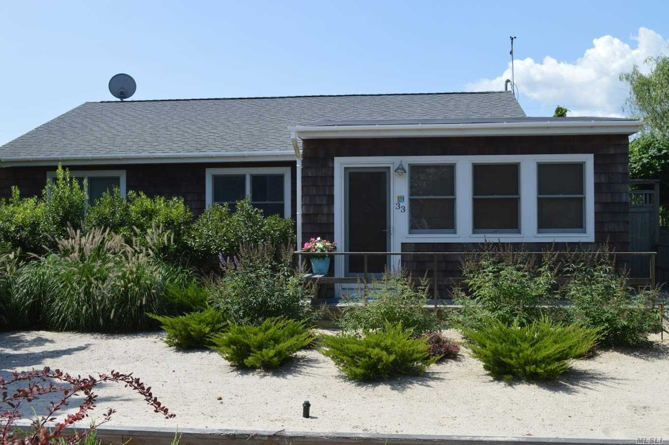 Photo of home for sale at 33 Sloop Walk, Ocean Beach NY
