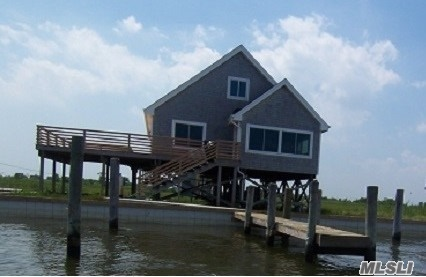 Photo of home for sale at 42 Oak Island, Oak Island NY
