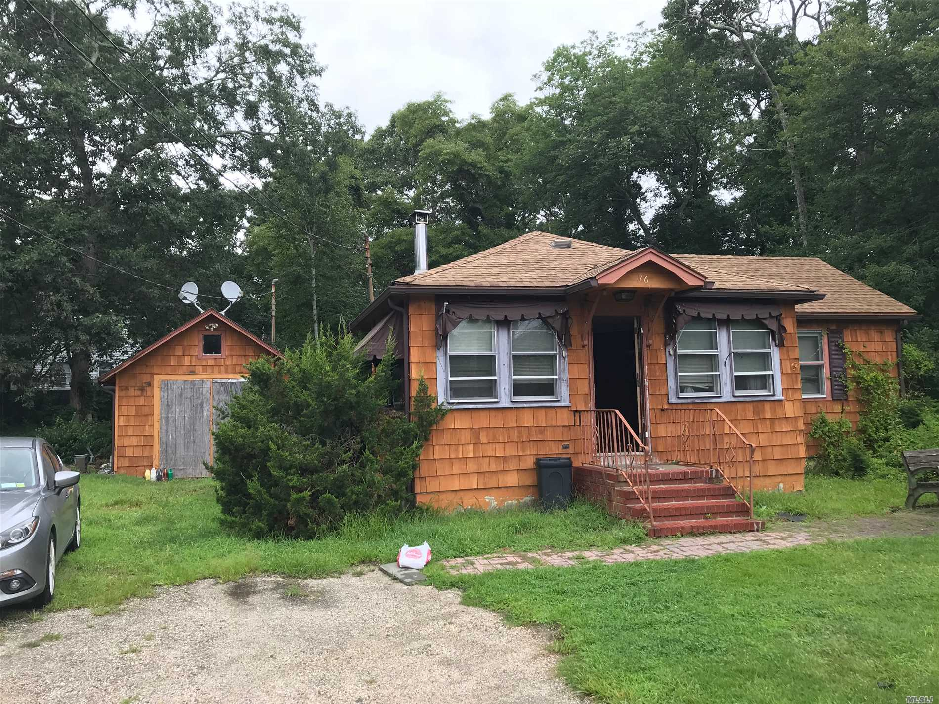 Photo of home for sale at 76 Riviera Dr, Mastic NY
