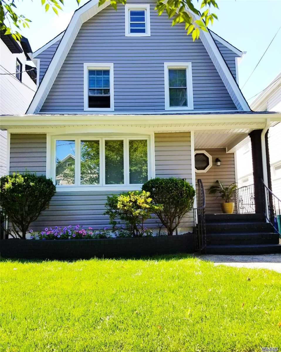 Photo of home for sale at 97-28 134th Ave, Ozone Park NY