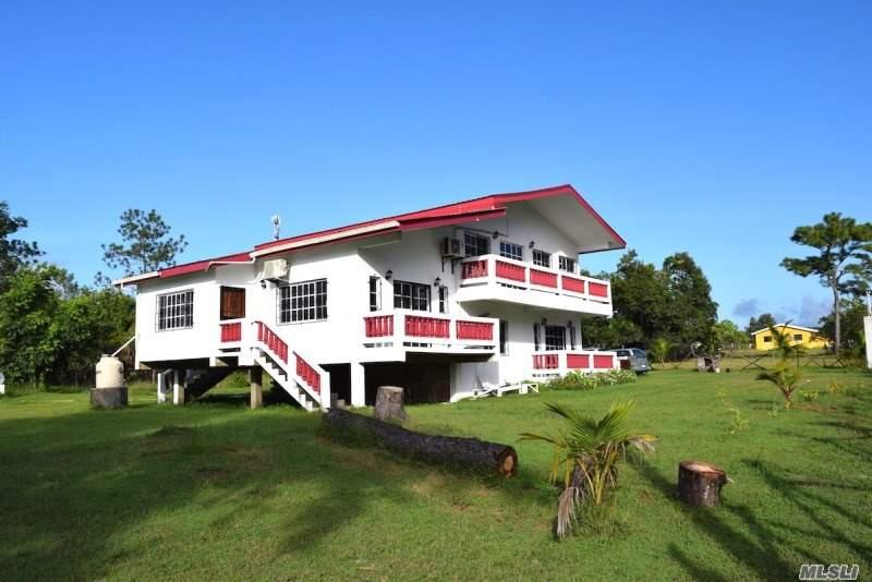 Photo of home for sale at Bermudian Landing Village, Belize NY