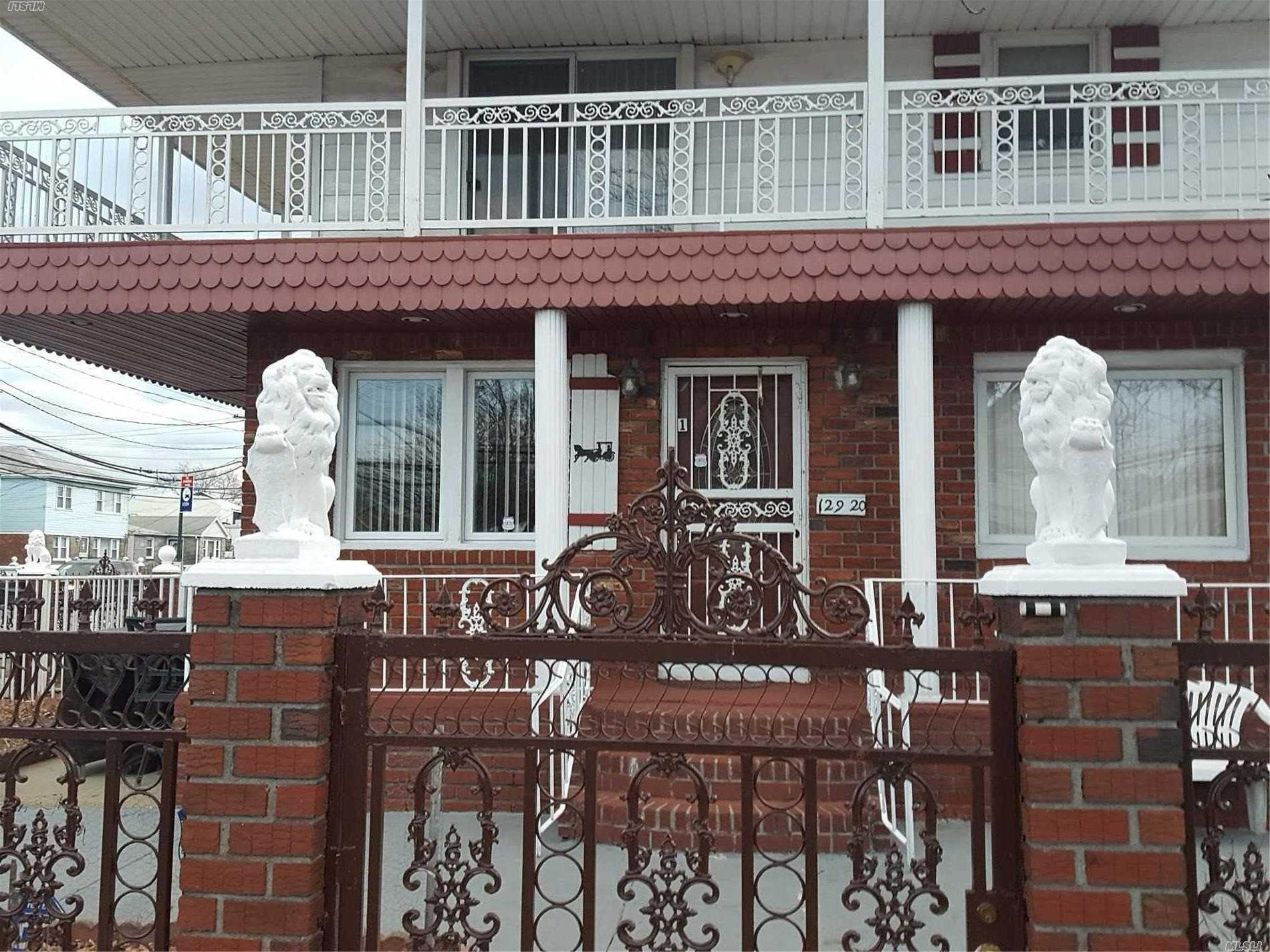 Photo of home for sale at 129-20 135 Ave, South Ozone Park NY