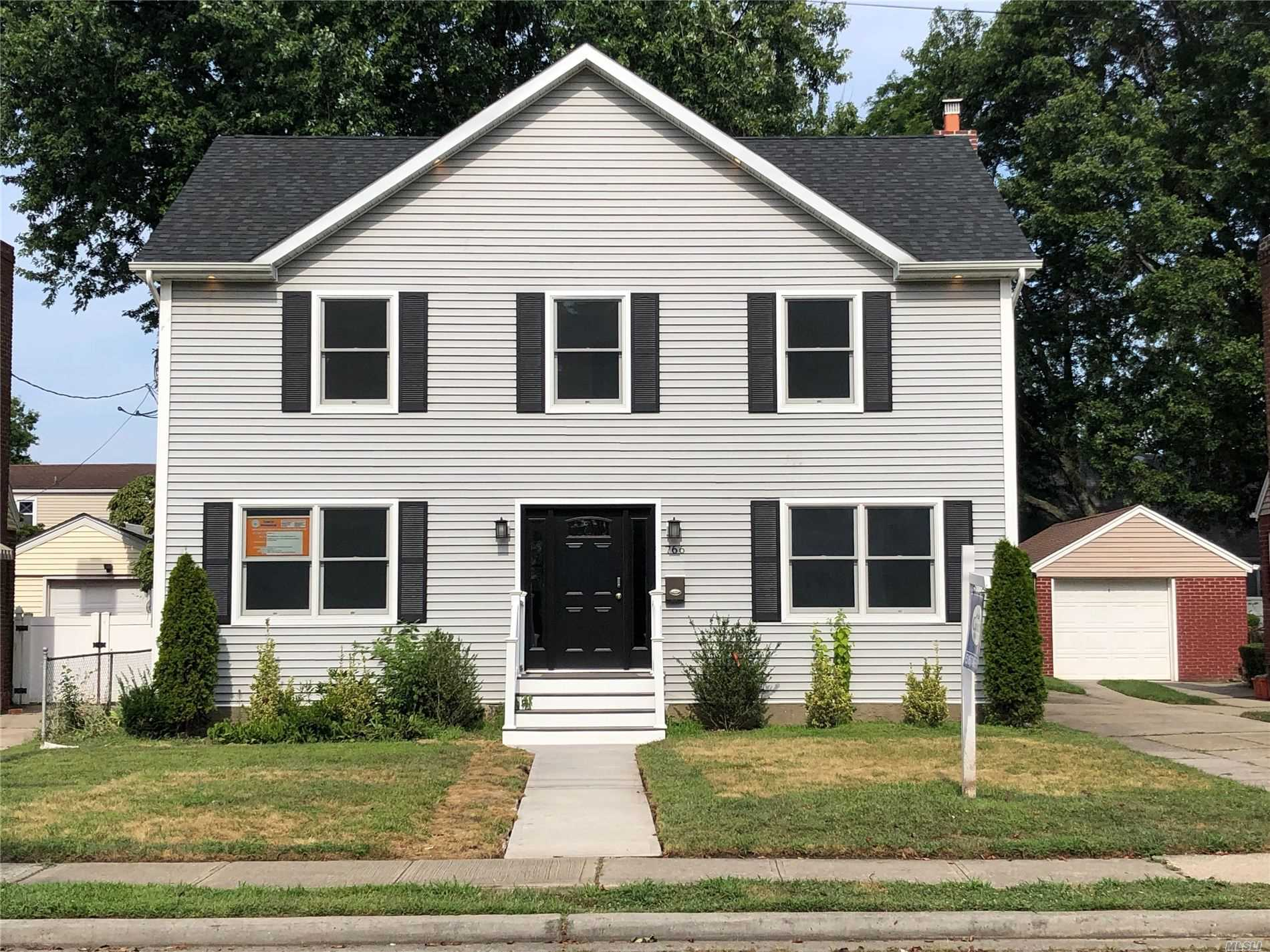 Photo of home for sale at 766 Harrison St, West Hempstead NY