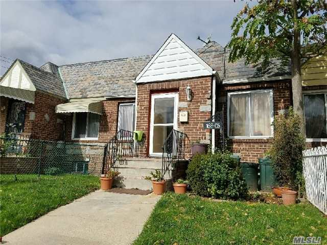 Photo of home for sale at 168-05 Foch Blvd, Jamaica NY
