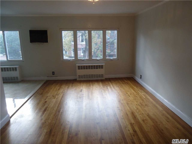 Photo of home for sale at 32-29 60 St, Woodside NY