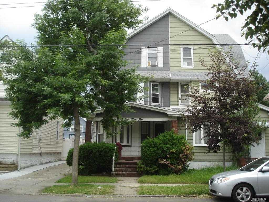 Photo of home for sale at 89-34 97th St, Woodhaven NY