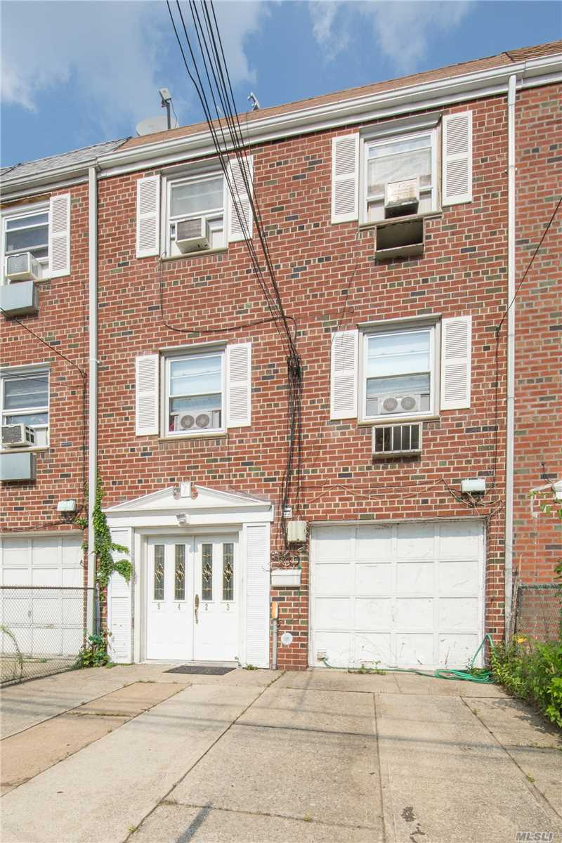 Photo of home for sale at 94-23 83rd St, Jamaica NY