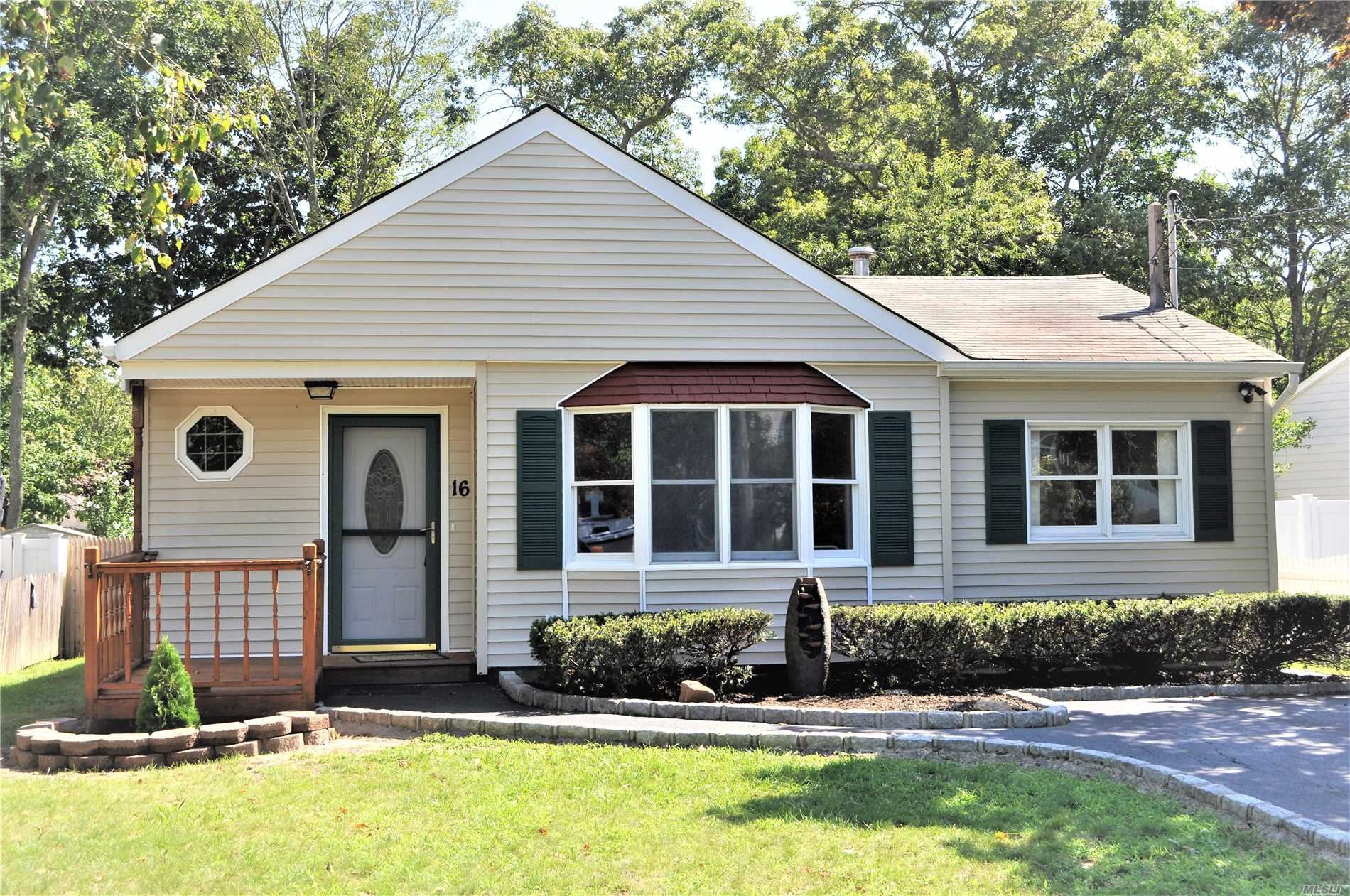 Photo of home for sale at 16 Tallwood Dr, Shirley NY