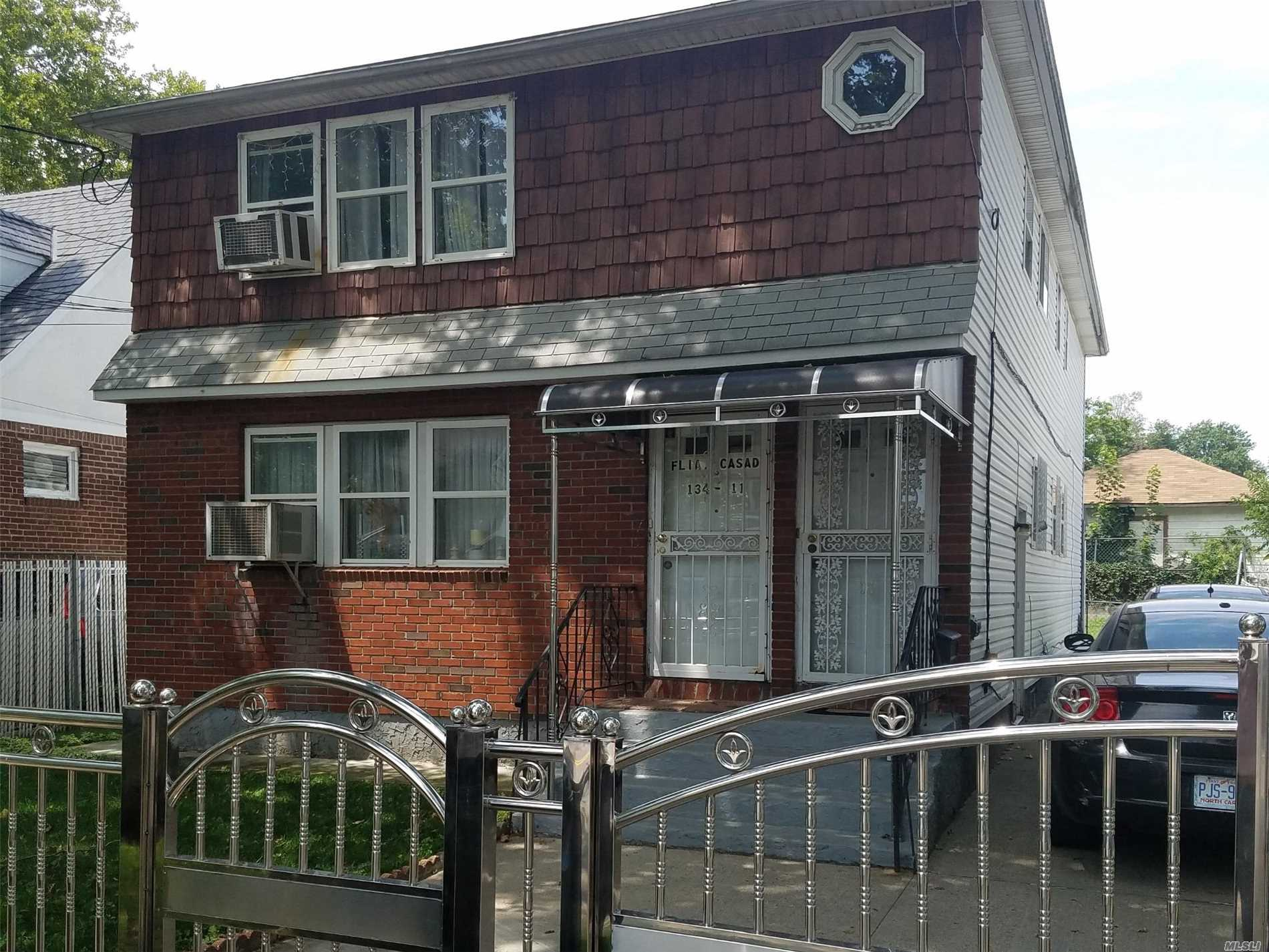Photo of home for sale at 134-11 107th Ave, Richmond Hill NY