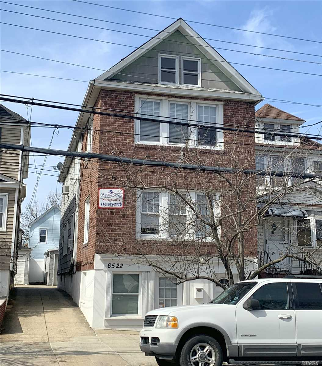 Photo of home for sale at 65-22 80th St, Middle Village NY