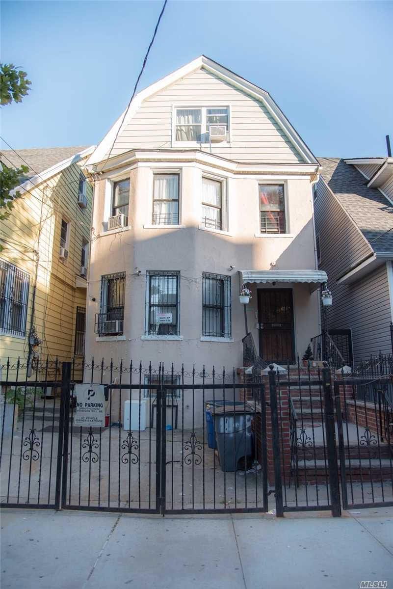 Photo of home for sale at 111-18 38th Ave, Corona NY