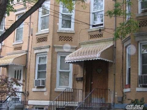 Photo of home for sale at 97-14 76 St, Ozone Park NY