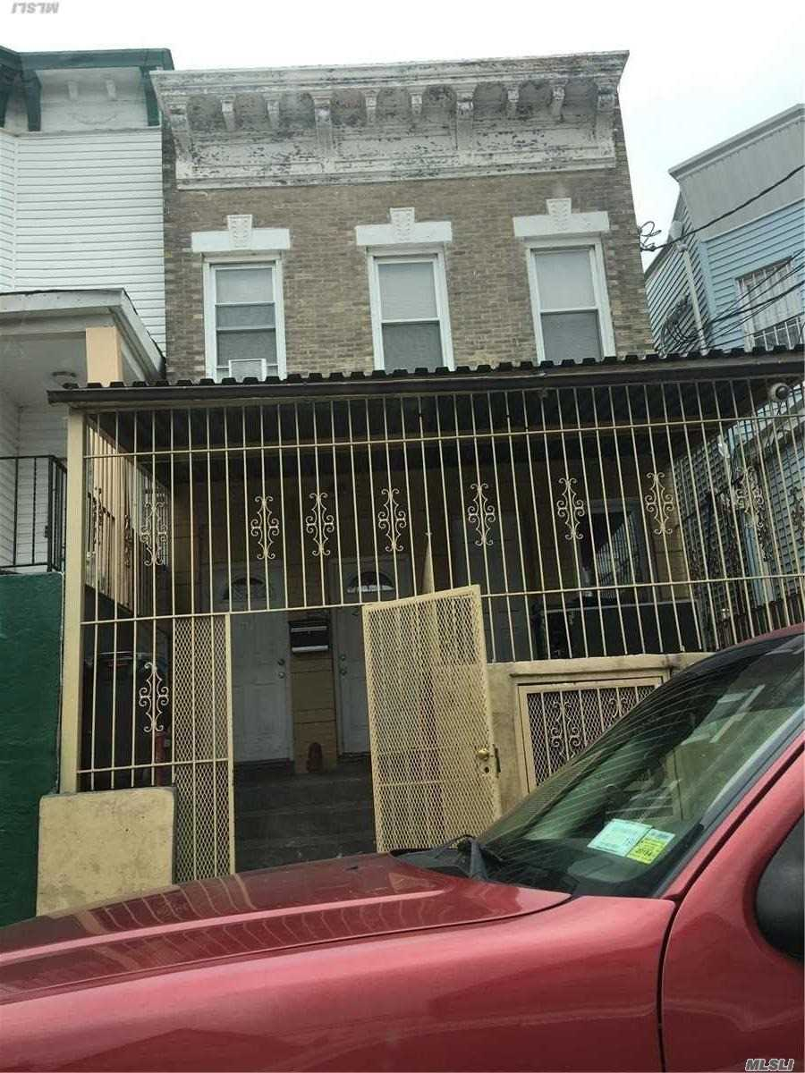 Photo of home for sale at 32-27 103rd St, East Elmhurst NY