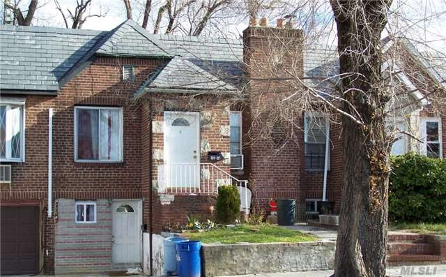 Photo of home for sale at 121-23 180th St, Jamaica NY