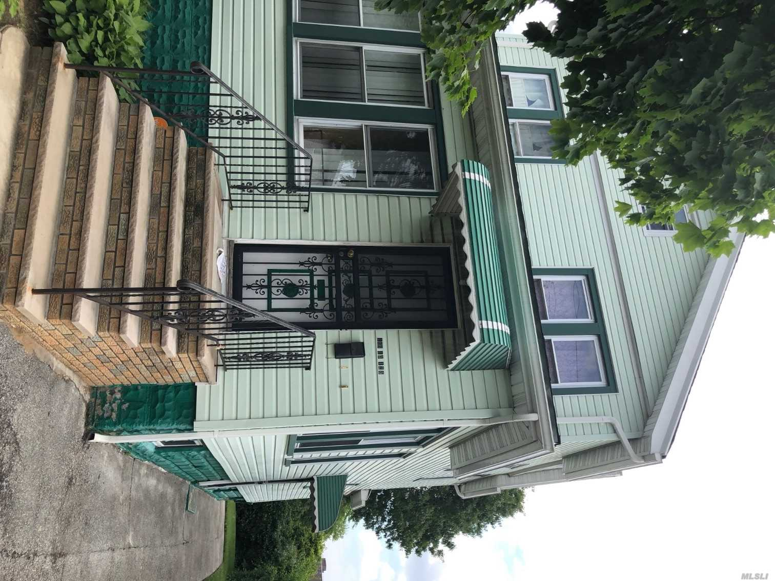 Photo of home for sale at 166-10 120th Ave, Jamaica NY