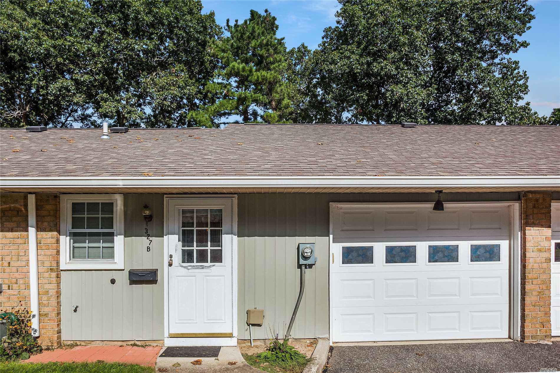 Photo of home for sale at 327 B Woodbridge Dr, Ridge NY